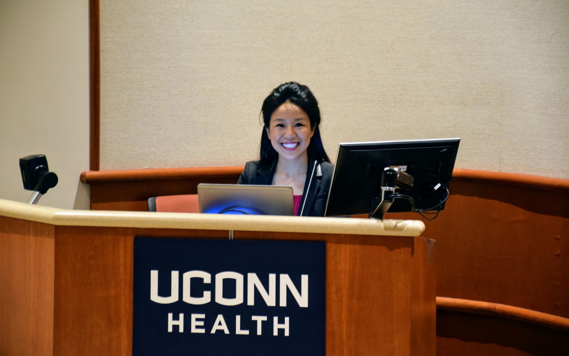 Maria Smiling at the Low Learning Center Podium